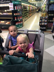 The twins have a great time at the store