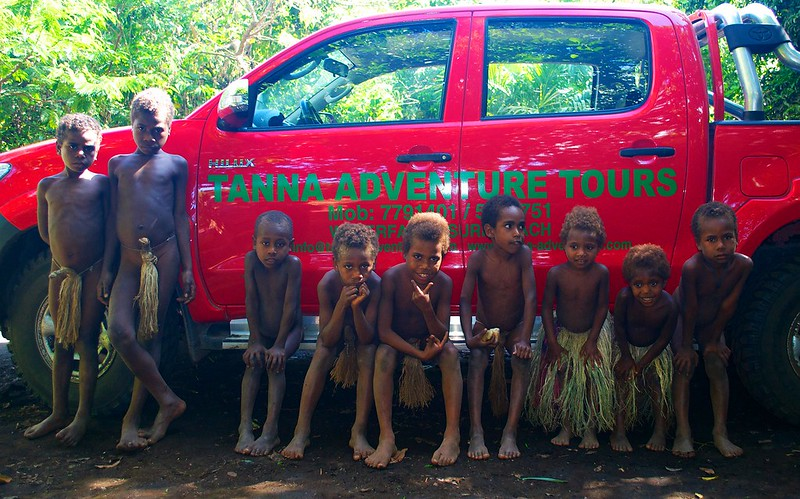 The Tanna-Adventures vehicle surrounded by village children from one of the kastom(custom) villages on Tanna Island .