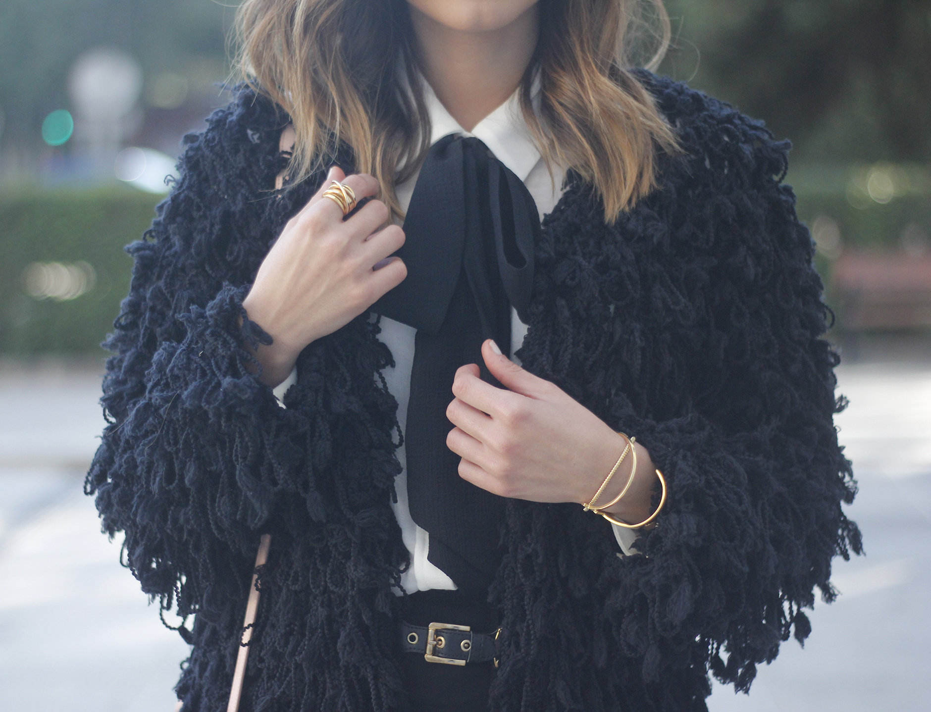 black jacket shirt with black bow coach pink bag heels outfit12