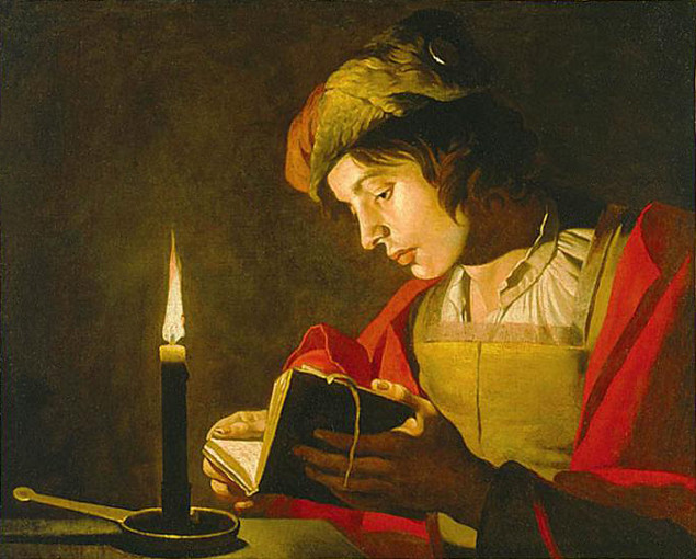 stomer_young_man_reading_candle_light