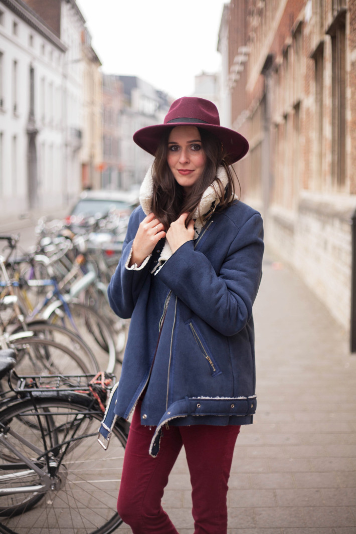 70s inspired burgundy wide brim hat, shearling coat, burgundy flares