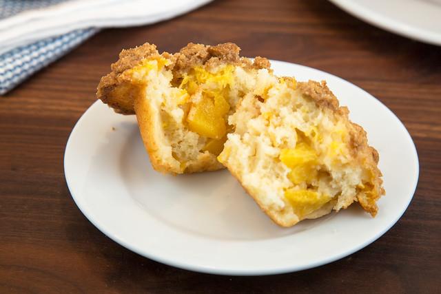 halved peach crumb muffin