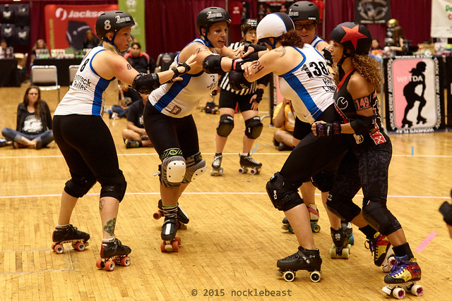 Demolition City's Bambi ThumpHer tries to get around Santa Cruz's defense.