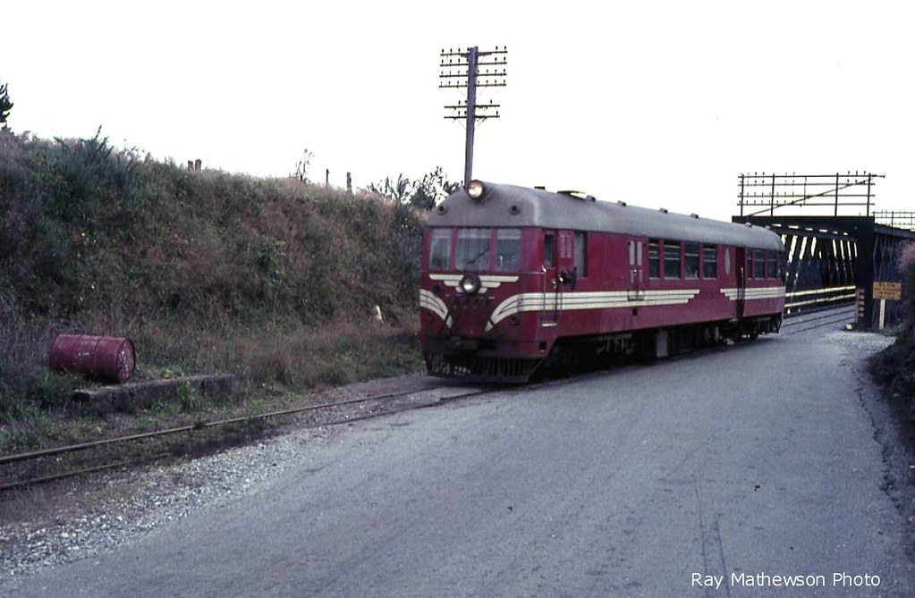 Ross Branch : Southbound Hokitika - Greymouth Vulcan railcar comes off the Taramakau road/rail bridges in 1965 or 1966