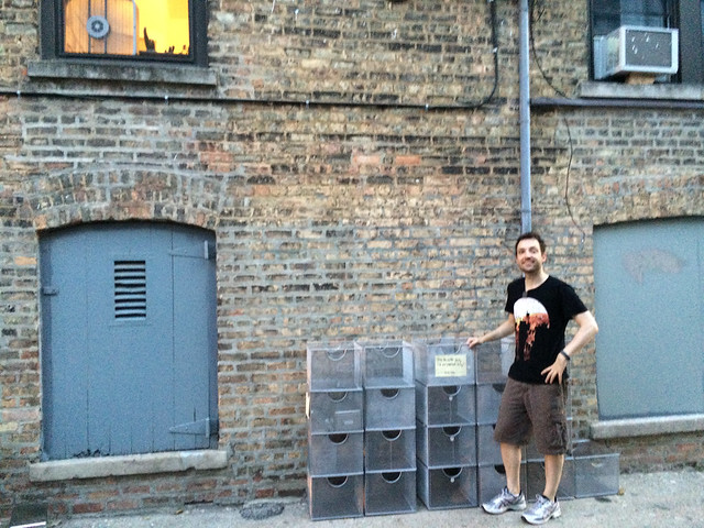Me standing by my stack of mesh boxes. That is my apartment window in the upper left.