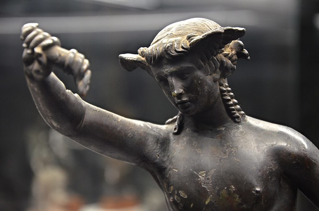 Bronze statuette of Hypnos with a crown of poppies and wings at his temples, he is pouring the magic philtre that puts living beings into sleep out of a horn, 1st century AD, copy of Hellenistic original, National Archaeological Museum of Florence