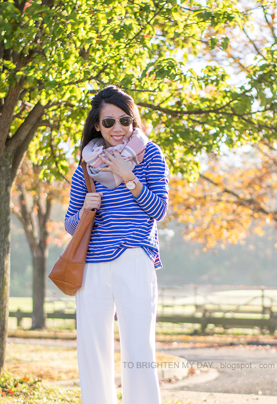 pink plaid scarf, bright blue striped top, white pants, cognac brown tote, oversized watch