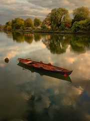 The lonely boat at sunset