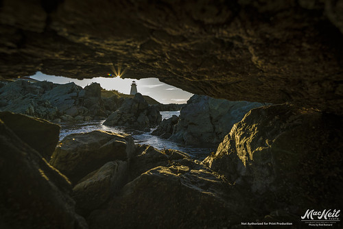 ocean sunset lighthouse rocks novascotia atlantic cave