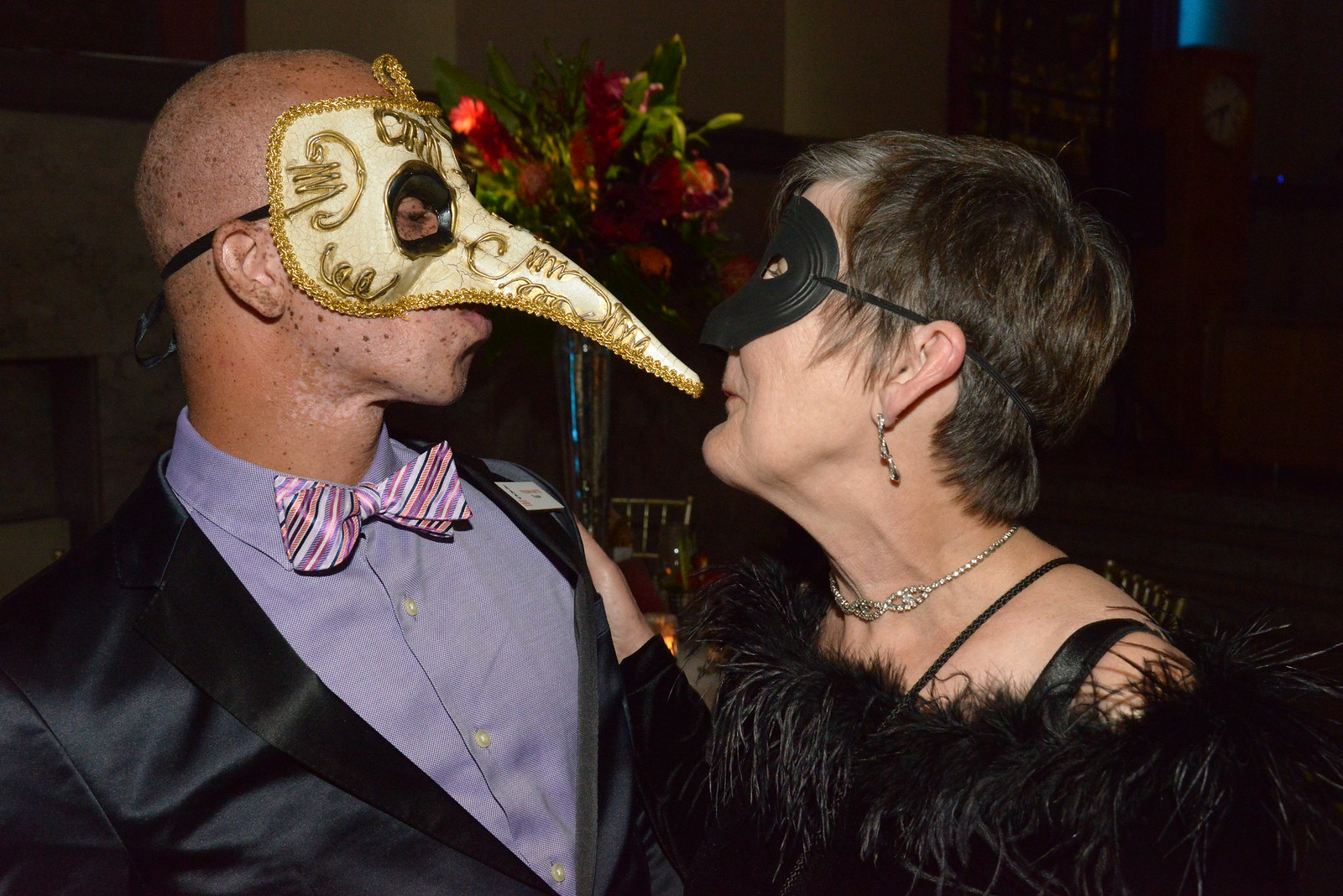 photo of two patrons in costume at the beaux arts ball