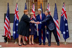 U.S. Defense Secretary Ash Carter reaches past U.S. Secretary of State John Kerry and his Australian counterpart, Foreign Minister Julie Bishop, as he shakes hands with Australian Defense Minister Marise Payne after posing for a group photo on October 13, 2015, at the Boston Public Library in Boston, Massachusetts, before their annual AUSMIN diplomatic and defense meetings. [State Department photo/ Public Domain]