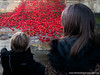 Mother and son look at Weeping Window in Liverpool