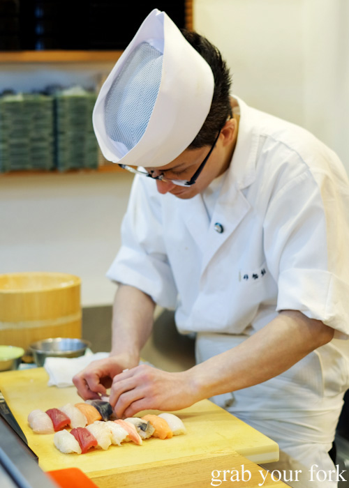 Sushi chef preparing nigiri sushi Tarche Sushi Corner near Otaru JR station