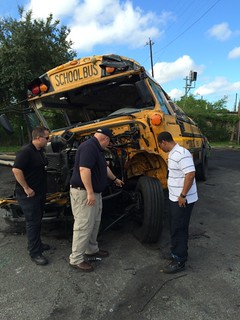 Brian Bragonier, NTSB investigator and Houston police officials, during on-scene investigation in Houston Texas where a school bus was struck by a passenger vehicle