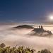 Corfe castle in the mist by john wines