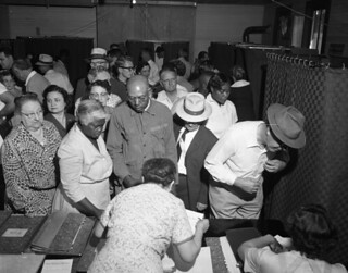 African American and white voters voting together in 1956 - Tallahassee