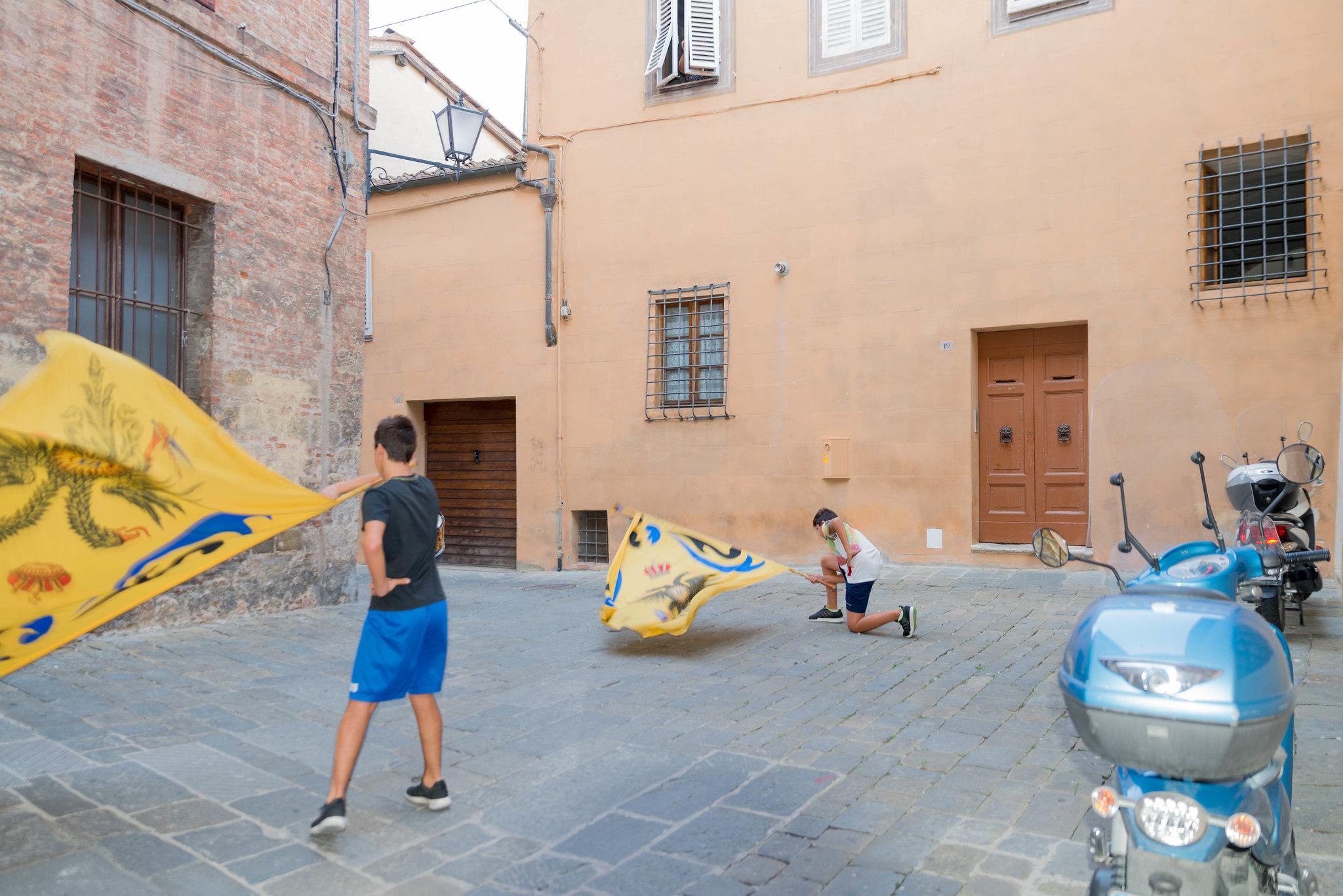 Siena children practicing flag tossing