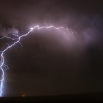 29. August 2015 - 20:37 - A positive lightning strike arches out from a small, isolated thunderstorm crashing against the mountains east of Phoenix, Arizona.