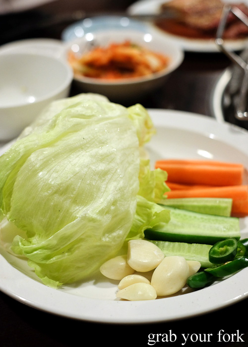 Lettuce, garlic, chilli, carrot and cucumber at Jang Tur Charcoal BBQ Restaurant, Canterbury