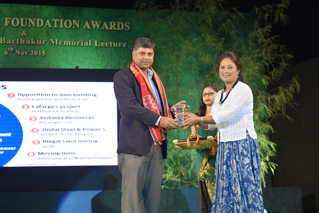 Ritwick Dutta, Winner of 2015 Green Legal Award receiving the Award from Ms. Hasina Kharbhih