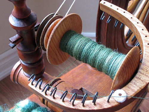 Spinning Tussah silk laceweight yarn on antique flax saxony spinning wheel