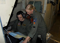 Lt.j.g. Shane Lewis examines a chart of New Zealand with an airman from the Royal New Zealand Air Force, Nov. 15.  (U.S. Navy/LTJG Kyle Burdick)
