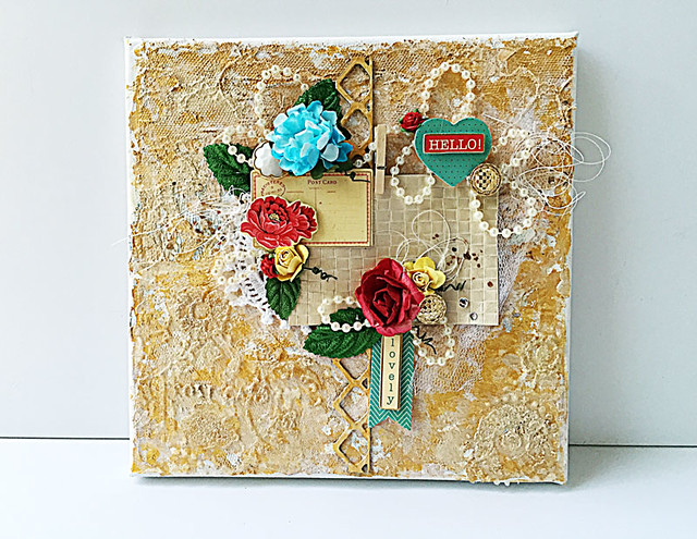 Mixed-media-canvas-with-leftover-lace-and-fabric