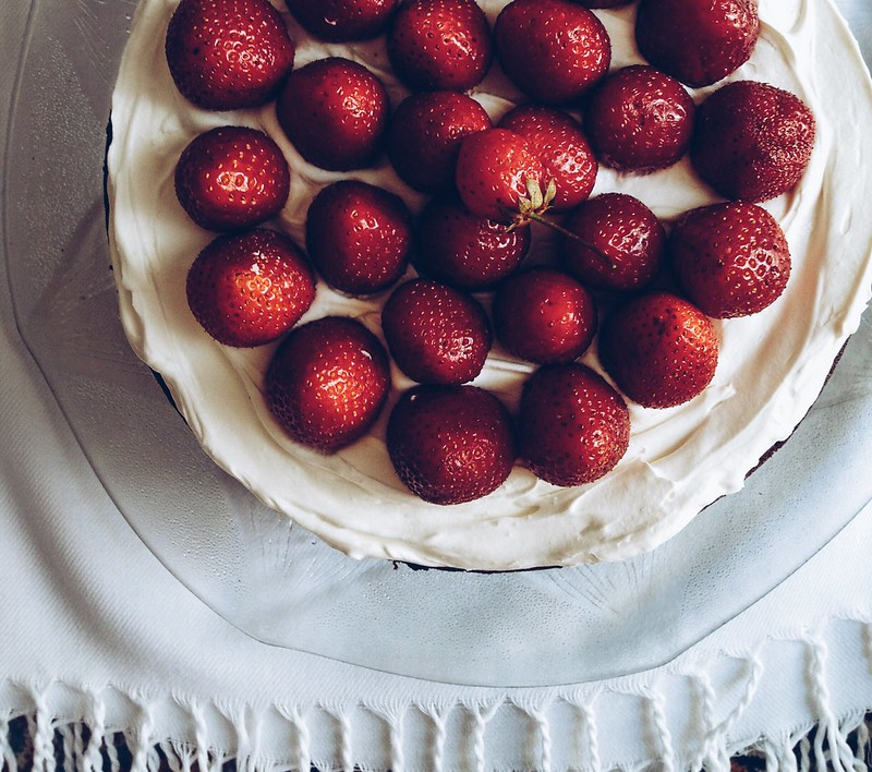 Vegan chocolate strawberrt cake with whipped coconut cream