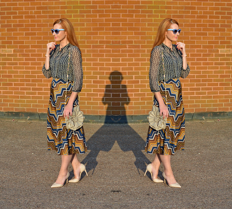 Pattern mixing | Sheer vintage blouse, chevron midi skirt