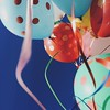 it's hard not to be happy when you're carrying around a dozen polka balloons!