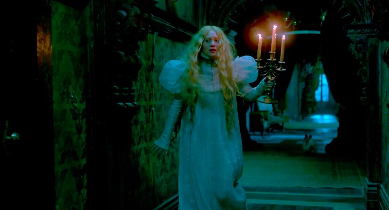 Mia Wasikowska navigates the haunted halls in CRIMSON PEAK.