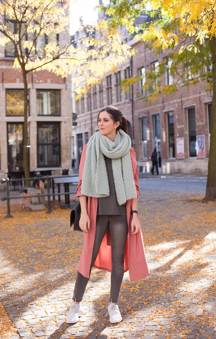 Outfit: pink duster coat, oversized scarf, white Nike roshe runs