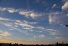 South view of morning sky, high tropical clouds moving in.
