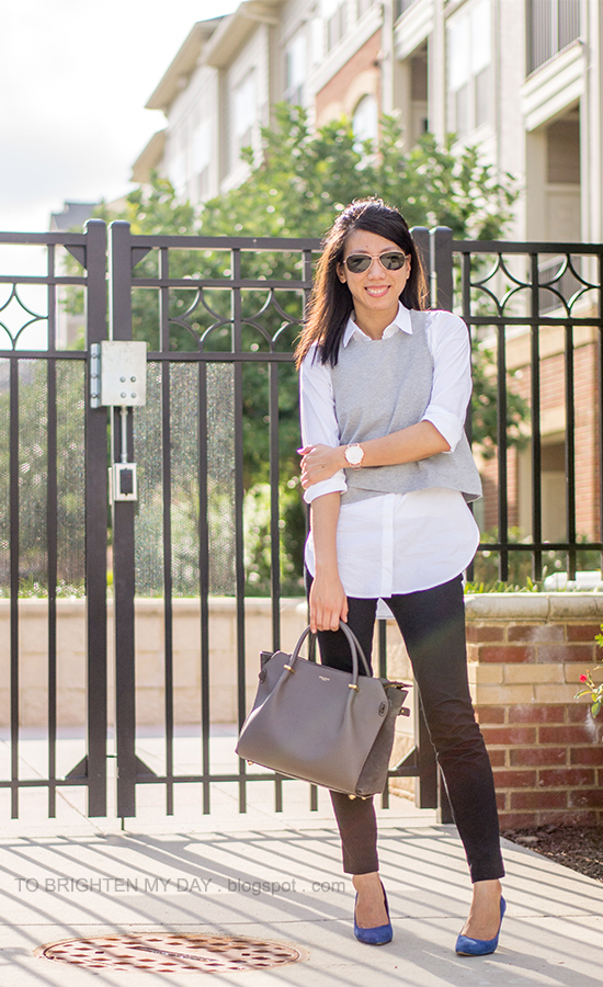 gray cropped vest, white dress shirt, black pants, oversized watch, blue suede pumps