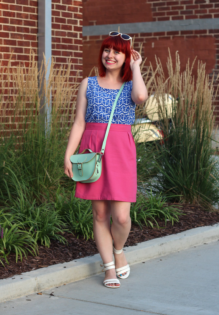 Blue Anchor Print Top, Pink Linen Pencil Skirt, Mint Green Brit-Stitch Purse, White Sandals, and Bright Red Hair