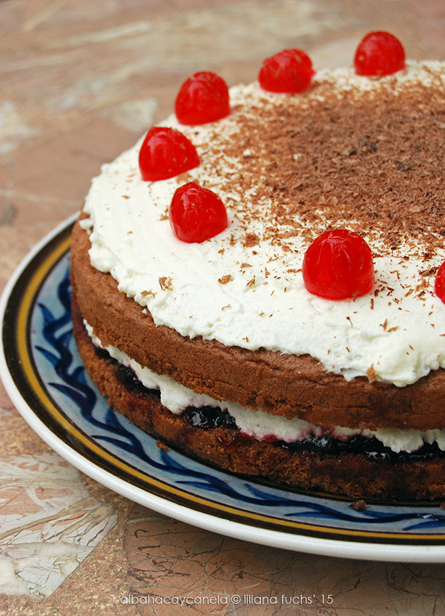 Chocolate cherry cake with whipped cream