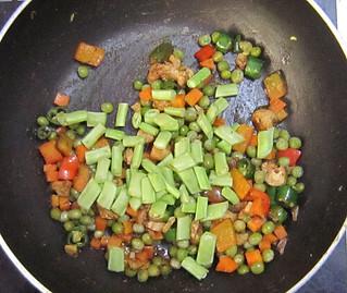 Egg chicken pulao - Add long peas