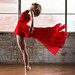 Red Dress En Pointe by Philip Payne