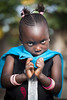 SENEGAL - November 5, 2013: Little shy Senegalese girl living on the island of Sipo in the Sine-Saloum Delta, near Toubacouta by CloudMineAmsterdam