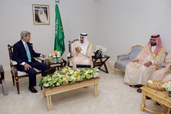 U.S. Secretary of State John Kerry sits with King Salman bin Abdulaziz of Saudi Arabia and Deputy Crown Prince and Defense Minister Mohammad bin Salman at the Four Seasons Hotel in Washington, D.C., on September 3, 2015, during a bilateral meeting preceding the King's visit with President Barack Obama. [State Department photo/ Public Domain]