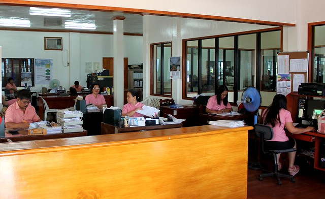 Staff undertake tasks in the newly-rehabilitated Jaro Municipal Hall. June 2015