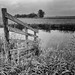 A small fence in an empty meadow. by Dikke Biggie.