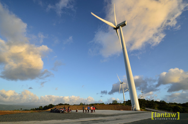 Dwarfed by the wind turbine