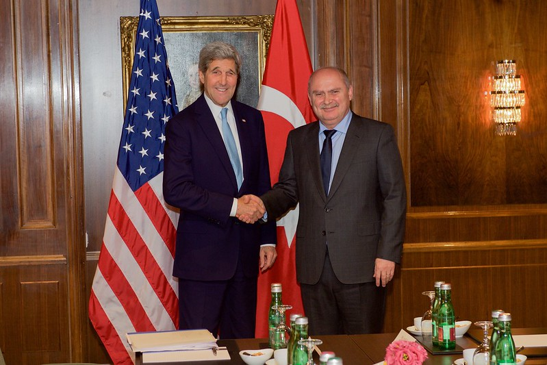 Secretary Kerry Shakes Hands With Turkish Foreign Minister Sinirlioglu Before Bilateral Meeting in Austria Focused on Syria
