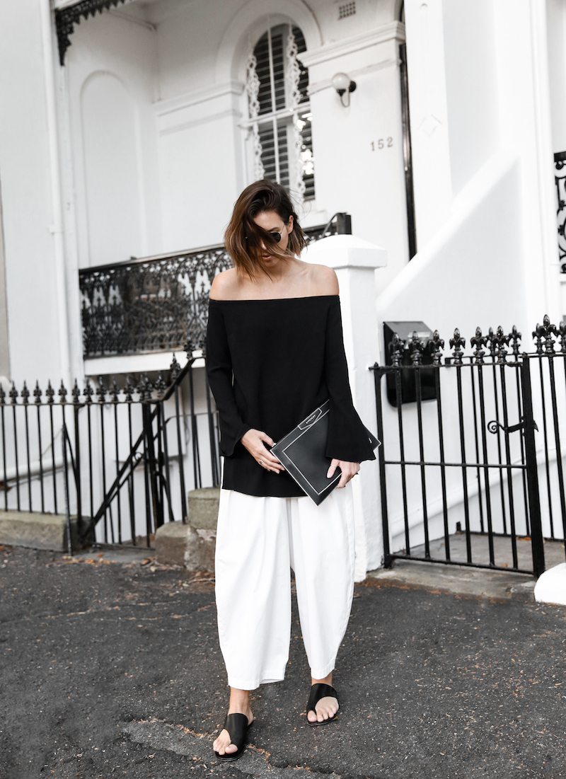 off shoulder top Ellery Queenie monochrome street style inspo black white Bassike pants ATP Rosa sandals Givenchy clutch resort off duty (2 of 11)