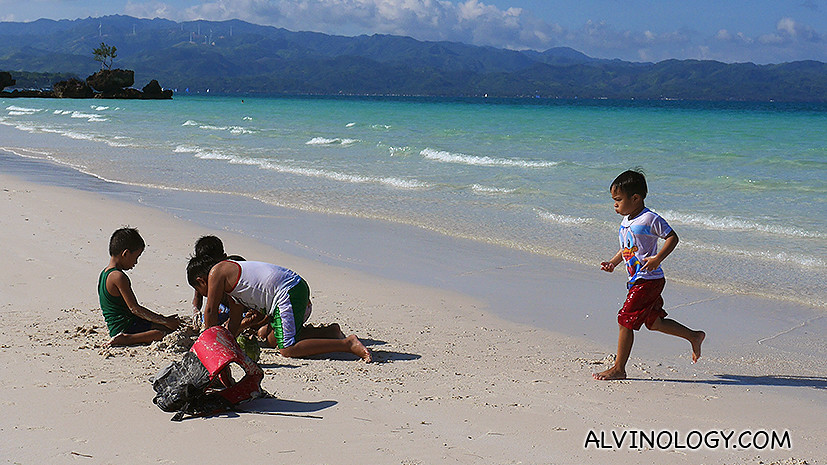 Kids playing by the beach