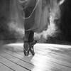 The feet of ballerina in the smoke