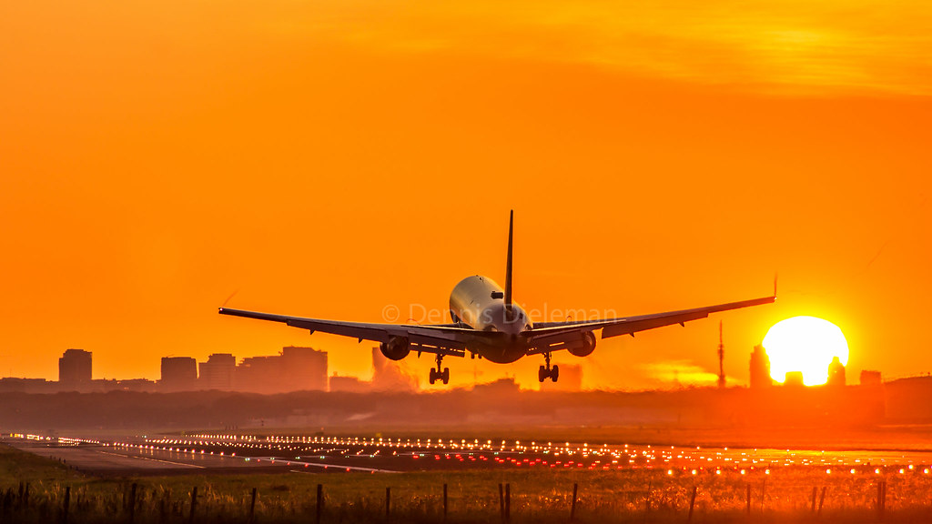 Boeing 767 on approach during sunrise