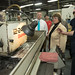 State Reps. J.P. Sredzinski and Jan Giegler look on during a tour of Noujaim Tool Co. Inc.