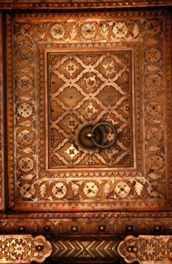 the richly carved doors of city palace jaipur